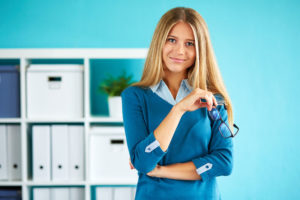 50870935 - young businesswoman with glasses standing in office